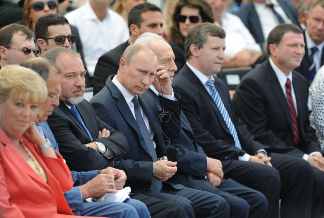 Russian President Vladimir Putin attends a ceremony to dedicate the Victory Monument in Netanya, North Israel, on June 25, 2012. UPI/Yin Dongxun/Pool