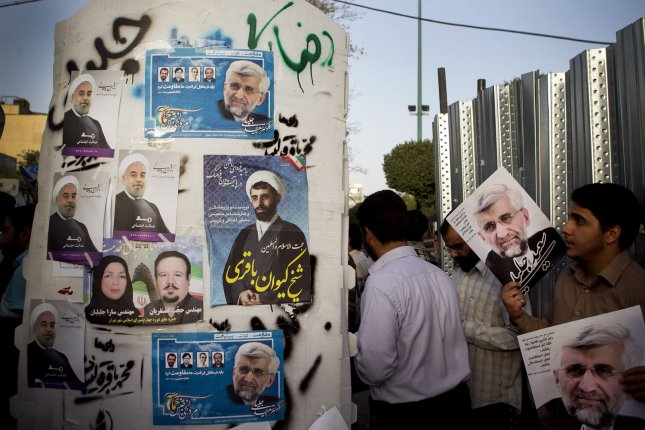 Supporters of Iran's top nuclear negotiator and presidential candidate Saeed Jalili holds his posters as they campaign in Tehran, Iran on June 6, 2013. Iran's presidential election will be held on June 14, 2013. UPI/Maryam Rahmanian