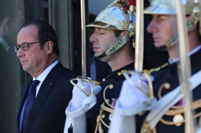 French President Francois Hollande awaits the arrival of German Chancellor Angela Merkel at the Elysee Palace in Paris on October 2, 2015. Merkel and Hollande will meet with Russian President Vladimir Putin and Ukrainian President Petro Poroshenko to discuss a lasting political solution in Ukraine, in accordance with the Minsk accords established by these four leaders earlier this year. Photo by David Silpa/UPI