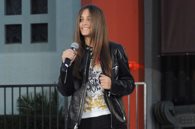 Paris Jackson introduces singer Justin Bieber to perform a tribute song for her father, the late pop star Michael Jackson, during a hand and footprint ceremony in Los Angeles on January 26, 2012. File Photo by Jim Ruymen/UPI