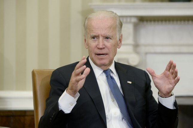 Vice President Joe Biden, pictured discussing the Cancer Moonshot Report in the Oval Office in October, told reporters Monday, after the Senate approved a bill funding the effort, that there was a chance he'll run for president in 2020. The remarks slightly over-shadowed the multi-billion dollar 21st Century Cures Act, which also reworks some of the FDA's approval processes and funds research not connected to the moonshot, in addition to funding the huge anti-cancer effort. Pool photo by Olivier Douliery/UPI