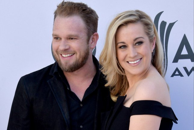 Singer Kellie Pickler (R) and Kyle Jacobs attend the 52nd annual Academy of Country Music Awards in Las Vegas on April 2. Season 3 of the couple's reality show I Love Kellie Pickler is to debut on Thursday. File Photo by Jim Ruymen/UPI