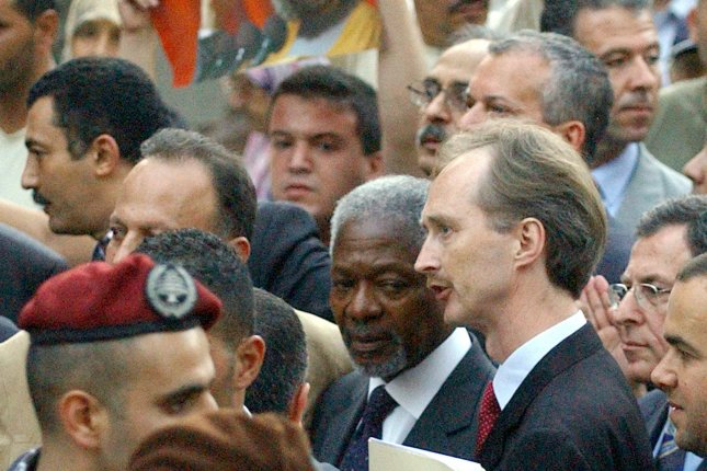 Kofi Annan (C) and then-U.N. Special Envoy to Lebanon Geir O. Pedersen (R) tour Beirut's bombed-out southern suburbs with Lebanese Prime Minister Fuad Saniora, other government officials and Hezbollah members of Parliament on August 28, 2006. Pedersen was appointed as U.N. special envoy to Syria on Wednesday. UPI File Photo