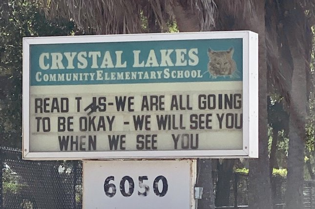 A message on the Crystal Lakes Elementary School notice board reassures students during the school closing due to the coronavirus fears in Boynton Beach, Florida, on March 28. Photo by Gary I Rothstein/UPI
