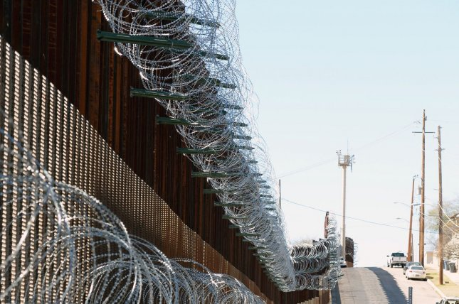 Barbed wire has been placed on the top and side of the fence along the United States-Mexico border in Nogales, Arizona, on February 8, 2019. The Arizona city has ordered Federal Officials to remove the barbed wire. Photo by Art Foxall/UPI