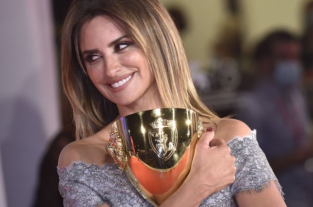 Penelope Cruz poses with the Coppa Volpi for Best Actress for Parallel Mothers on the awards winner photocall during the 78th Venice International Film Festival on Saturday. Photo by Rocco Spaziani/UPI
