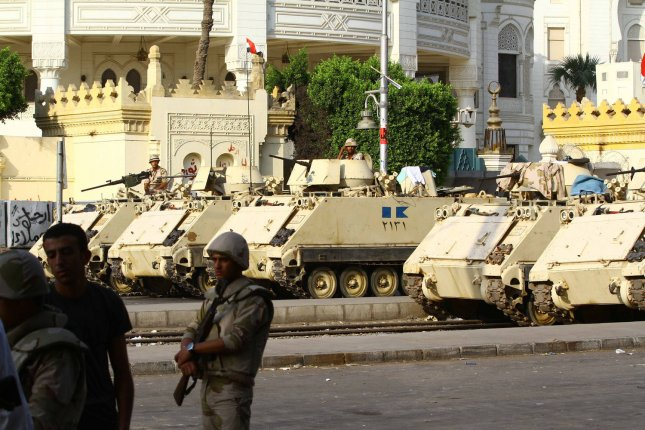 Egyptian Army armoured vehicles sit parked at a checkpoint in Cairo, Egypt, July 08, 2013. At least 42 people were killed and more than 300 injured during a violent incident early on Monday morning at a sit-in protest in support of recently deposed Egyptian President Mohamed Morsi. Supporters were demanding the release of Morsi, who was deposed by the Egyptian military last week. UPI/Ahmed Jomaa