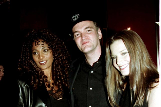 Director/screen writer Quentin Tarantino turns 51 March 27. In a file photo from 1997, he poses with the stars of his film Jackie Brown Pam Grier (left) and Bridget Fonda at the Ziegfeld Theatre in New York City. (UPI/Ezio Petersen)