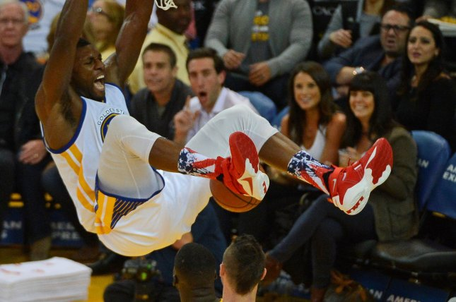 Golden State Warriors' Festus Ezeli slams in two. Photo by Terry Schmitt/UPI