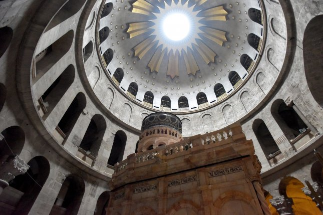 The renovated Edicule, traditionally believed to be the tomb of Jesus, is seen in the Church of the Holy Sepulchre in Jerusalem's Old City, on Tuesday. A Greek restoration team has completed a historic renovation of the Edicule, the shrine believed to be the cave where Jesus was buried and rose to heaven. Photo by Debbie Hill/UPI