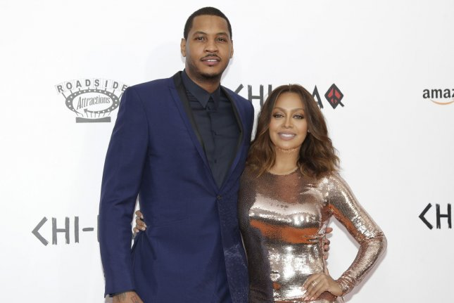 La La Anthony (R), pictured with Carmelo Anthony, said she will spend the holidays with the Oklahoma City Thunder player and their son. File Photo by John Angelillo/UPI