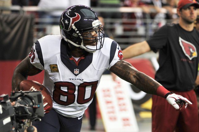 Former Houston Texans receiver Andre Johnson scores a touchdown in the first quarter of the Texans-Arizona Cardinals game on November 10, 2013 at University of Phoenix Stadium in Glendale, Arizona. File photo by Art Foxall/UPI