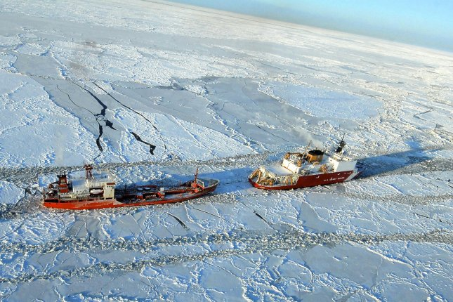 The U.S. Coast Guard Cutter Healy escorts the Russian tanker Renda 250 miles south of Nome, Alaska, in the Bering Sea on January 6, 2012. The vessels were transiting through ice up to 5-feet thick in this area. Photo by Sara Francis/U.S. Coast Guard