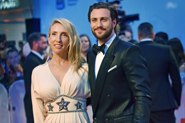 Aaron Taylor-Johnson (R) with his wife Sam Taylor-Wood. Taylor-Johnson has joined Christopher Nolan's next film along with Kenneth Branagh. File Photo by Christine Chew/UPI