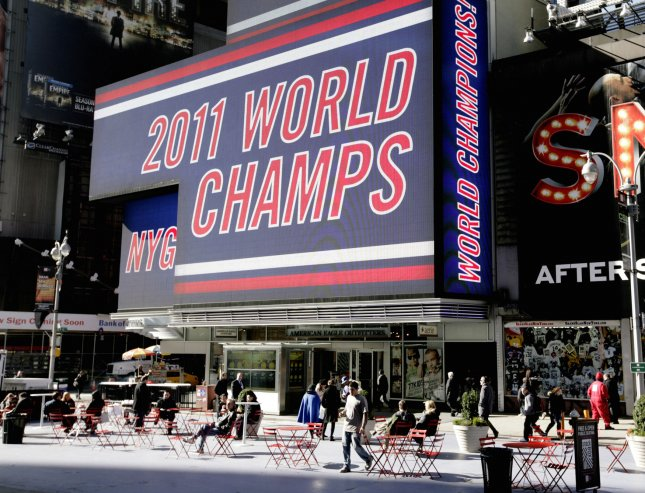 Men's testosterone soars when winning against competitors, not friends. A huge sign in Time Square honors the New York Giants football team the day after they won the Superbowl on February 6, 2012 in New York City. UPI/Monika Graff