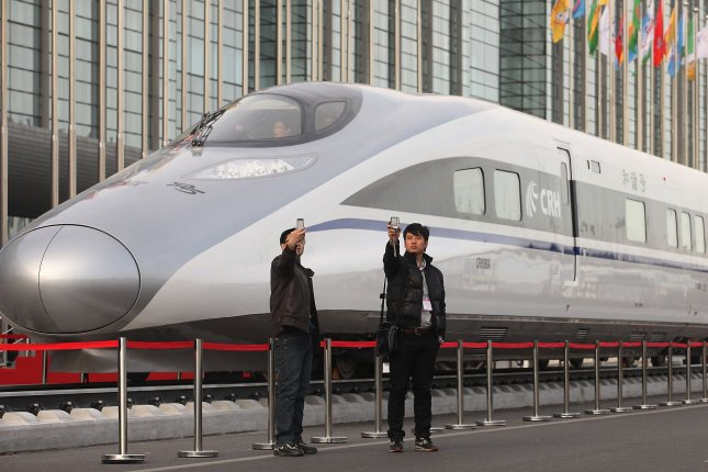 Visitors look at China's homegrown bullet train, the CRH380A, which set an operating speed record of 302 miles per hour in 2010. China leads the world with 4,680 miles of high-speed rail network, and thousands of miles of new high-speed railways are under construction nationwide. (File/UPI/Stephen Shaver)