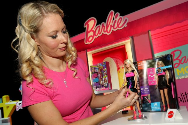 Natalie Atkins demonstrates how a stylus activates LED lights on Barbie's dress which is part of the Barbie's Life in a Dreamhouse series during the 110th annual American International Toy Fair held at the Jacob Javits Center on February 10, 2013 in New York City. (File/UPI /Monika Graff)