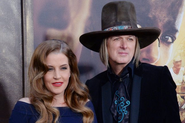 Lisa Marie Presley (L) and Michael Lockwood attend the Los Angeles premiere of Mad Max: Fury Road on May 7, 2015. The couple split in June after 10 years of marriage. File Photo by Jim Ruymen/UPI