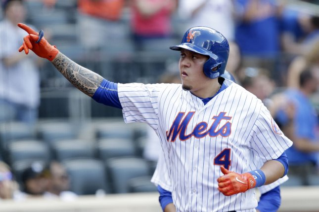New York Mets' Wilmer Flores celebrates after scoring. File photo by John Angelillo/UPI