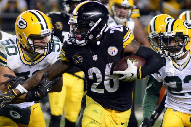 Former Pittsburgh Steelers running back Le'Veon Bell (26) sat out during the 2018 season after declining to sign a franchise tag tender. Bell led the NFL with 321 carries while piling up 1,946 yards from scrimmage during his 2017 All-Pro campaign. File Photo by Archie Carpenter/UPI