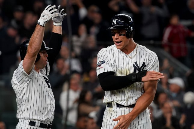 New York Yankees runners Brett Gardner and Aaron Judge (R) celebrate after they score against the Minnesota Twins in the fifth inning in Game 1 of the American League Division Series on Friday at Yankee Stadium in New York City. Photo by Ray Stubblebine/UPI
