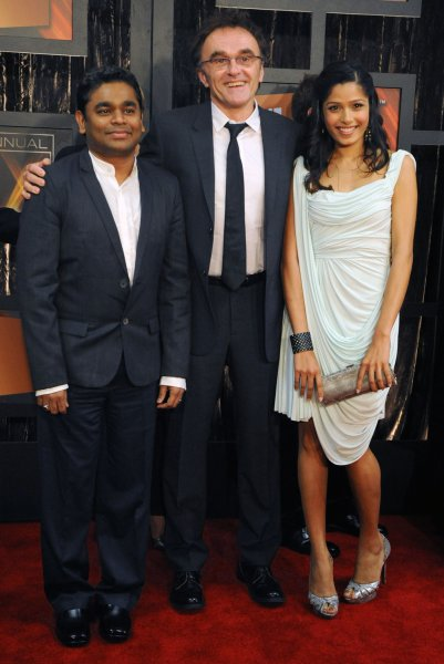 Danny Boyle, who directed the motion picture Slumdog Millionaire attends the 14th annual Critics' Choice Awards with composer A. R. Rahman (L) and actress Freida Pinto in Santa Monica, California on January 8, 2009. (UPI photo/Jim Ruymen)
