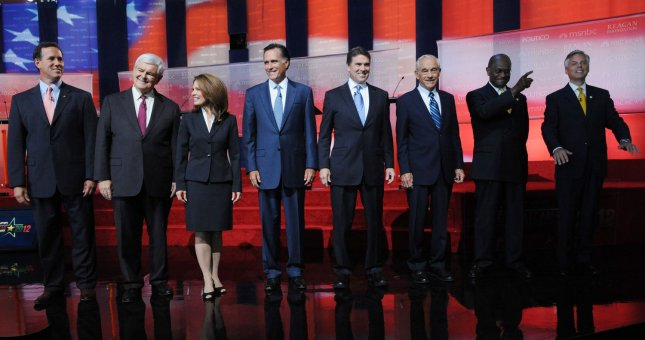 Presidential candidates Rick Santorum, Newt Gingrich, Michelle Bachman, Mitt Romney, Rick Perry, Ron Paul, Herman Cain and Jon Huntsman Jr. (L-R) arrive on stage before the start of the Republican presidential primary debate at the Ronald Reagan Presidential Library in Simi Valley, Calif., Sept. 7, 2011. UPI/Jim Ruymen