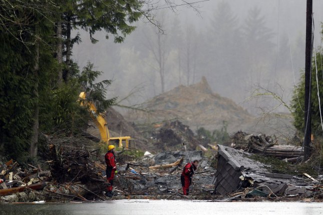 Search and rescue personnel work in the debris field on on March 27, 2014 in Oso, Washington. UPI/Ted Warren/Pool