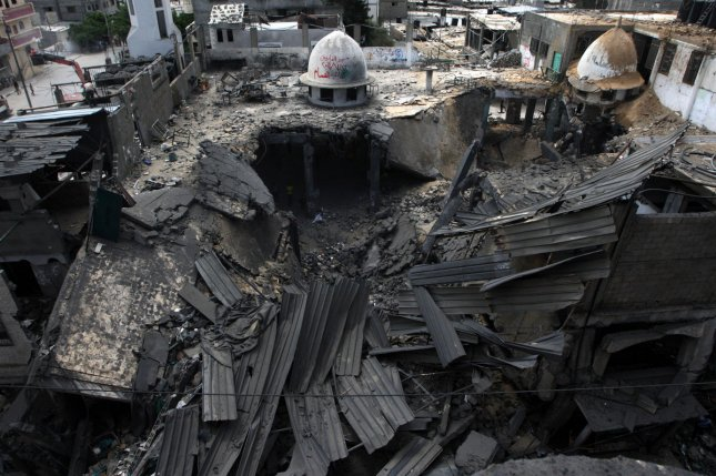 The al-Faroq mosque is reduced to rubble following an overnight Israeli military strike in Rafah, Gaza Strip on July 22, 2014. UPI/Ismael Mohamad