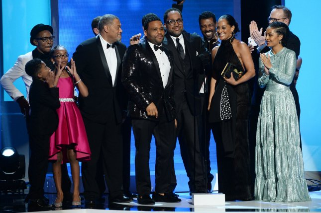 The cast of black-ish appear onstage after winning the best comedy series award at the 48th NAACP Image Awards at the Pasadena Civic Auditorium in Pasadena on February 11. Photo by Jim Ruymen/UPI