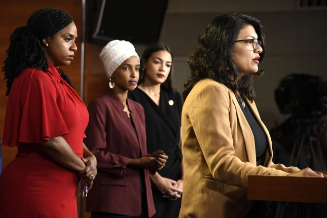 Rep. Rashida Tlaib of Michigan speaks to reporters July 15 at the U.S. Capitol, as Rep. Ilhan Omar of Minnesota, center left, looks on. Photo by Mike Theiler/UPI