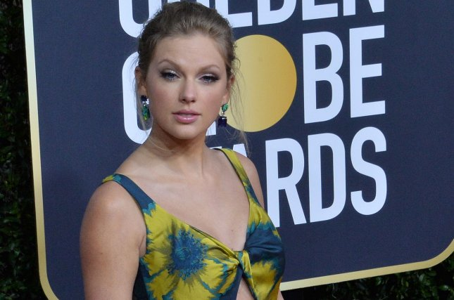 Taylor Swift Evermore and Folklore ranked at Nos. 1 and 3 on the Billboard 200 chart Saturday. File Photo by Jim Ruymen/UPI