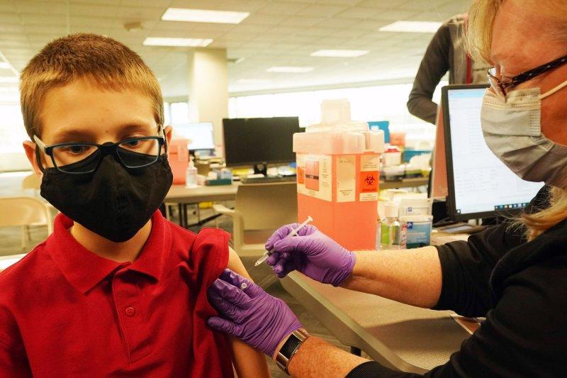Brendan Goldsborough, 12, receives a coronavirus vaccine shot from nurse Kathy Farrar in Kirkwood, Mo., on May 13. File Photo by Bill Greenblatt/UPI