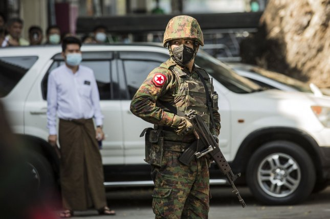 Junta soldiers stand guard in downtown Yangon, Myanmar, on February 2, one day after a military coup overthrew the civilian government. File Photo by Xiao Long/UPI