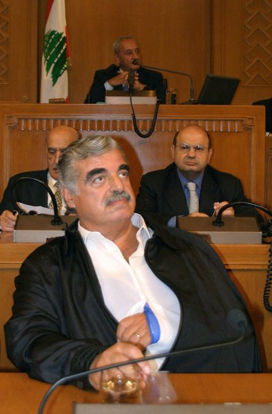 Lebanese Prime Minister Rafik Hariri, holding his broken shoulder, attends a parliament session that was held in Beirut Friday September 3, 2004 to amend the Constitution for extending the term of pro-Syrian President Emile Lahoud by another three years. The amendment comes in defiance of international pressure that culminated Thursday night with a U.N. Security Council resolution calling for holding free presidential elections and withdrawal of all foreign troops. (UPI Photo/Mohammed Tawil)