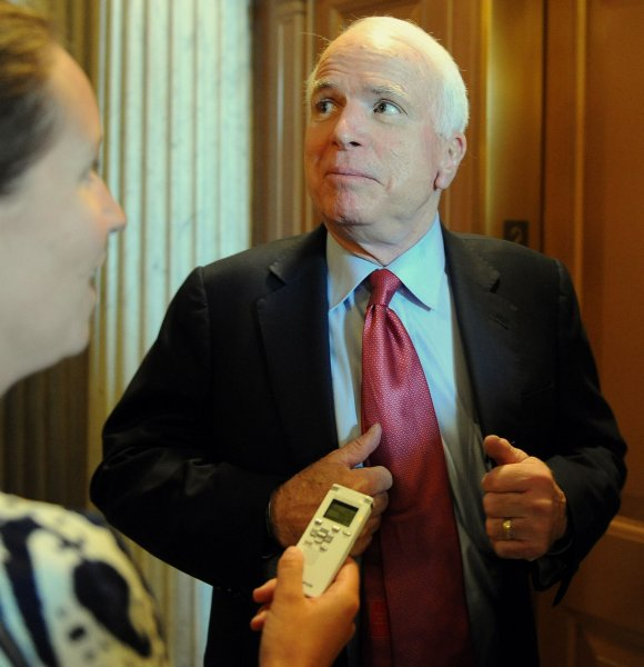Sen. John McCain, R-AZ, speaks with a reporter after a cloture vote on the financial reform bill on Capitol Hill in Washington on July 15, 2010. The vote passed which allows a final vote on passage of the bill later today. UPI/Roger L. Wollenberg
