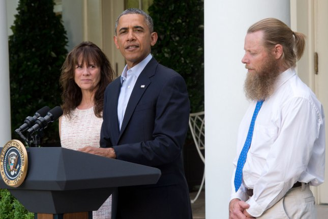 As the parents of as Sgt. Bowe Bergdahl, Jani Bergdahl (left) and Bob Bergdahl (right) look on, President Obama (center) makes a statement regarding the release of their son Sgt. Bowe Bergdahl by the Taliban, May 31, 2014, in the Rose Garden at the White House in Washington, DC. Army Sgt. Bowe Bergdahl was taken prisoner after leaving his base in east Afghanistan on June 30, 2009. UPI/J.H. Owen/Pool