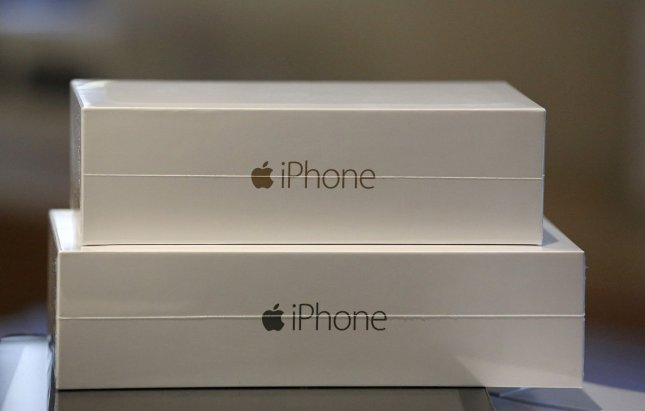 Boxes containing the two new iPhone 6 models are seen at the Apple Store near Place de l'Opera following the release of the next generation devices today in Paris on September 19, 2014. The iPhone 6 and the larger iPhone 6 Plus feature improved camera autofocus, increased storage capacity, and NFC Apple Pay mobile wallet. UPI/David Silpa