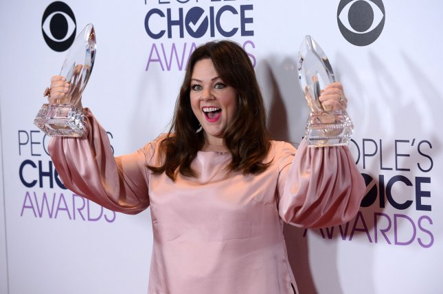 Actress Melissa McCarthy appears backstage with her award for Favorite Comedic Movie Actress and Favorite Comedic TV Actress on Wednesday during the 42nd annual People's Choice Awards at the Microsoft Theater in Los Angeles. Photo by Jim Ruymen/UPI