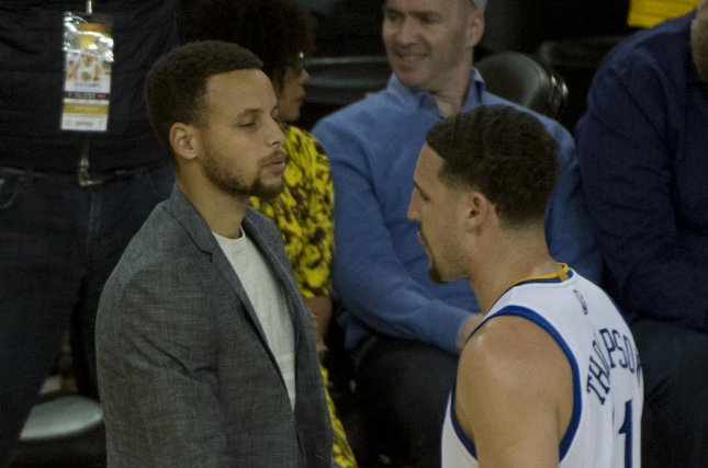 Golden State Warriors' Stephen Curry shakes Klay Thompson's hand in the fourth period against the Portland Trail Blazers in game two of the NBA Western Semis at Oracle Arena in Oakland, California on May 3, 2016. Photo by Terry Schmitt/UPI