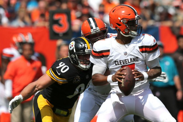 Cleveland Browns DeShone Kizer looks to pass as Pittsburgh Steelers T.J. Watt prepares to hit him during the first quarter at First Energy Stadium in Cleveland, Ohio September 10, 2017. File photo by Aaron Josefczyk/UPI