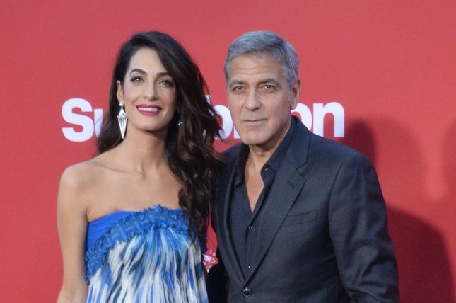 George & Amal Clooney Donate $500000 to March For Our Lives