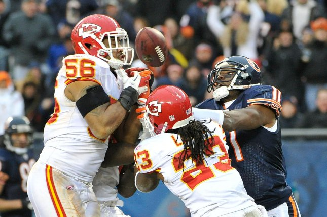 Former Kansas City Chiefs inside linebacker Derrick Johnson (56) and former Chiefs free safety Kendrick Lewis (23) break up a pass intended for ex-Chicago Bears wide receiver Roy Williams (11) during the fourth quarter on December 4, 2011 at Soldier Field in Chicago. File photo by Brian Kersey/UPI