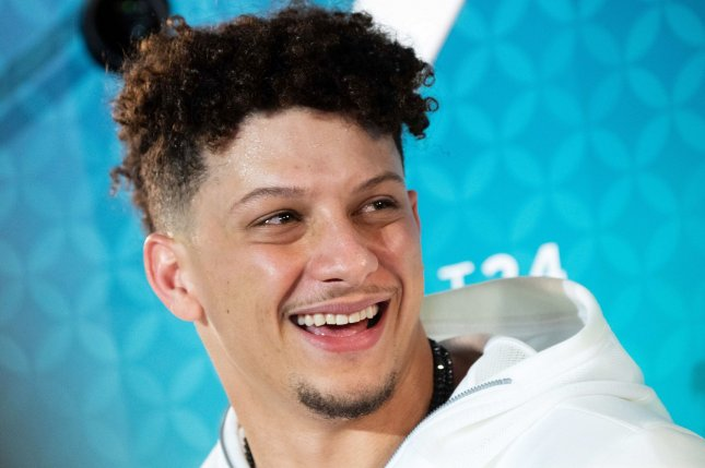 Kansas City Chiefs quarterback Patrick Mahomes, shown speaking to the media Monday in Miami, is averaging four passing touchdowns per game this postseason. Photo by Kevin Dietsch/UPI