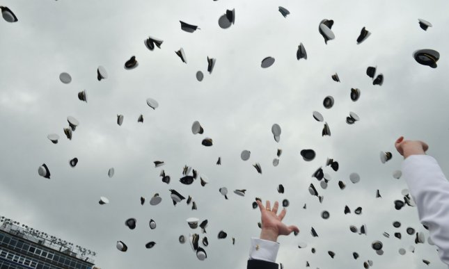 Navy midshipmen throw their hats into the air at the end of the U.S. Naval Academy Graduation and Commissioning ceremonies in Annapolis, Maryland on May 28, 2010. UPI/Alexis C. Glenn