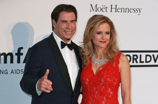 John Travolta and Kelly Preston arrive at the 21st amfAR Cinema Against AIDS 2014 gala at the Hotel du Cap in Antibes, France on May 22, 2014. The event, held each year during the annual Cannes Film Festival, raises funds for AIDS research. UPI/David Silpa