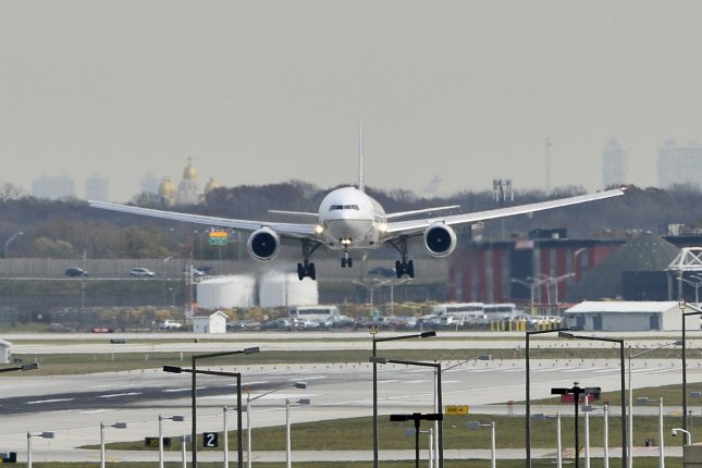 A plane lands at O'Hare International Airport on November 5, 2014 in Chicago. The EPA on Wednesday proposed regulating greenhouse gas emissions from airplanes. File photo by Brian Kersey/UPI