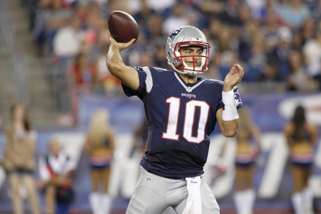 9de24b4c0 New England Patriots quarterback Jimmy Garoppolo (10) throws a pass in the  third quarter of the preseason game against the Green Bay Packers at  Gillette ...