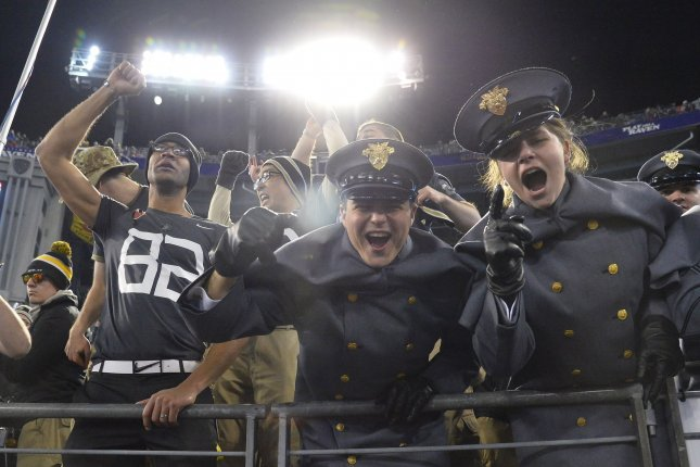Army fans cheers. Photo by David Tulis/UPI
