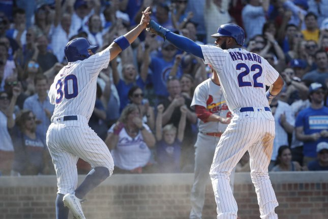 Chicago Cubs Jason Heyward (22) celebrates with Jon Jay (30) after scoring against the St. Louis Cardinals in the sixth inning at Wrigley Field on September 15, 2017 in Chicago. Photo by Kamil Krzaczynski/UPI